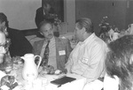Pastor of First Friends Church in Vancouver, Washington, talks with Jonathan Peterson, Pastor's Luncheon speaker and pastor of the First Baptist Church of Grant Pass, Oregon by George Fox University Archives