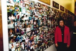 Woman stands in front of picture wall by George Fox University Archives