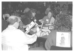 People at the Homecoming Food Fair by George Fox University Archives