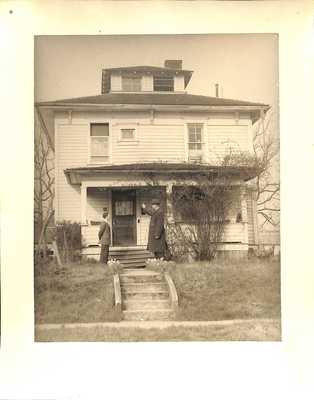 Hoover and unidentified young man in front of the Hoover Minthorn House, Newberg, OR