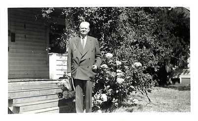 Herbert Hoover in front of the Hoover-Minthorn House Museum