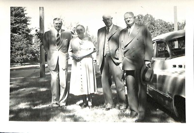 Levi Pennington and Herbert Hoover, with unidentified individuals