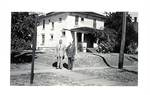 Herbert Hoover and unknown in front of Hoover-Minthorn House by George Fox University Archives