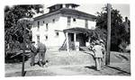 Levi Pennington and Herbert Hoover inspect the Hoover-Minthorn House