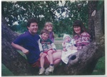 Family Photo in a Tree at Camp Tilikum by George Fox University Archives
