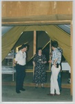 People Standing Around Talking at Camp Tilikum by George Fox University Archives