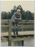Man Standing on a Dock at Camp Tilikum by George Fox University Archives