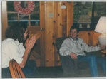 Two People Sitting and Talking in a Cabin at Camp Tilikum by George Fox University Archives