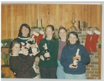 Five Ladies Holding Martinelli's Sparkling Cider in Front of a Fireplace at Camp Tilikum by George Fox University Archives