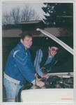 Two Men Working on a Vehicle at Camp Tilikum by George Fox University Archives