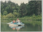 Man and Child Fishing in a Paddleboat at Camp Tilikum by George Fox University Archives