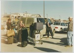People Loading Luggage into a Van by George Fox University Archives