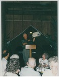Man Speaking to a Crowd While Holding a Building Model at Camp Tilikum by George Fox University Archives
