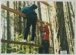 People on the Ropes Course at Camp Tilikum by George Fox University Archives